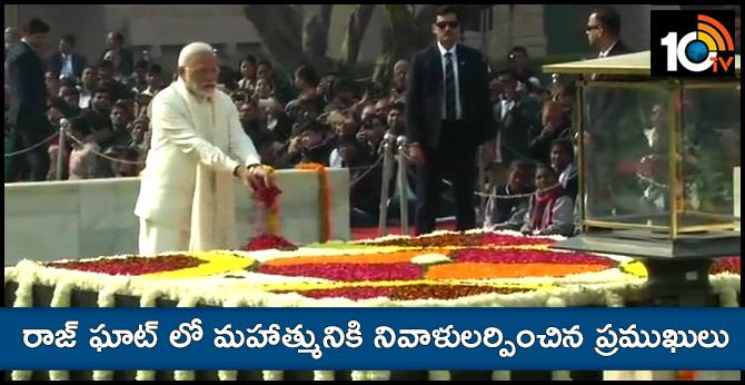 Prime Minister Narendra Modi and Vice-President M Venkaiah Naidu pay tribute to MahatmaGandhi at Rajghat