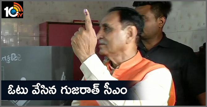 Gujarat CM cast vote at a polling booth in Anil Gyan Mandir school in Rajkot