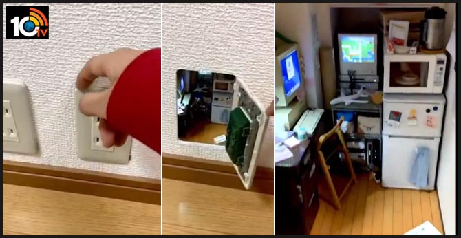 Complete with TV and computer, Japanese artist creates mini room inside power outlet