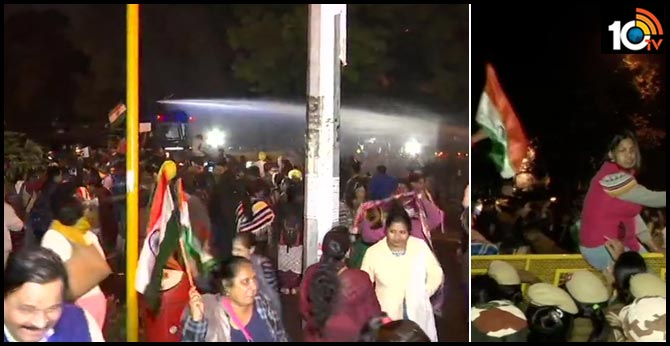 Protesters who are holding a candle march from Raj Ghat to India Gate try to jump barricades