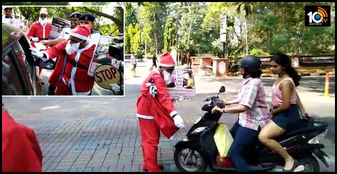 Traffic Police personnel dressed as SantaClaus and distributed sweets