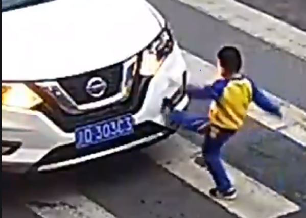 little Boy vents anger at driver after car sends his mother flying