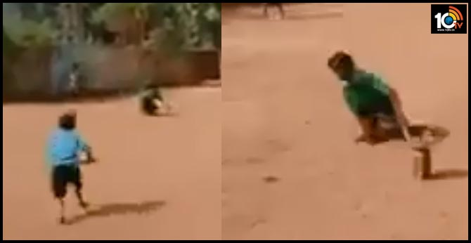 physically challenged kid playing gully cricket