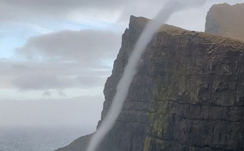 Incredible footage shows water flowing upwards - after waves were caught in a 'sea vortex'