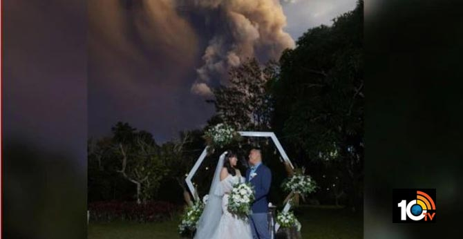 Couple Continues With Wedding As Philippines.. Taal Volcano Spews Ash Into Air
