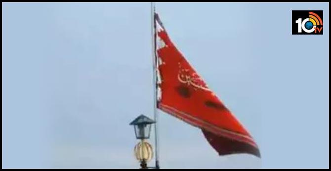 Iran unfurls symbolic red flag