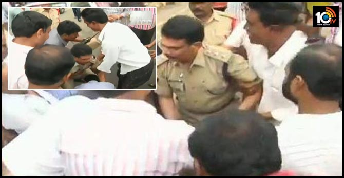 Protesters fell at feet of Deputy Superintendent of Police(DSP) Veera Reddy, who in turn fell at the feet of protesters in Mandadam in Amravati district.