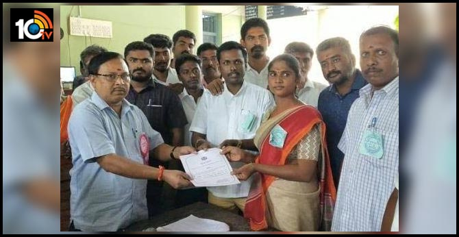 Transgender Riya receiving the certificate of victory from the Returning Officer in Tiruchengode