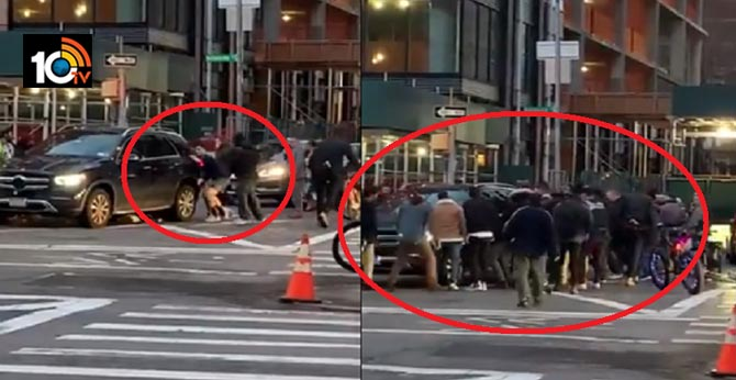 a pedestrian trapping them under an SUV. Onlookers just lifted the SUV,