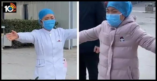 "heartbreaking video: Chinese nurse in coronavirus hit hospital gives her sobbing daughter ""air hug"" of coronavirus effect"