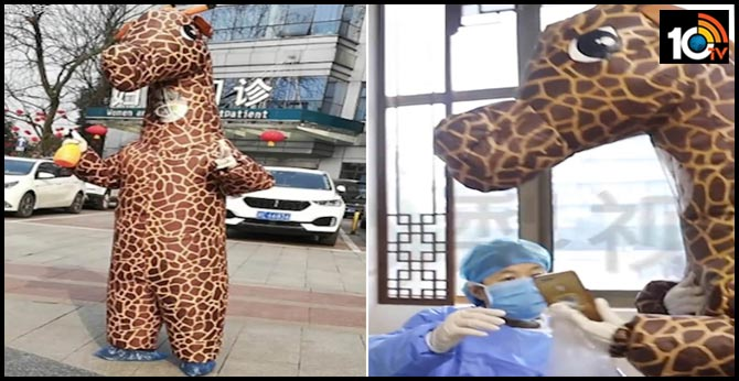Chinese woman dons an inflated giraffe costume to hospital as a way to protect her from coronavirus after failing to buy a face mask