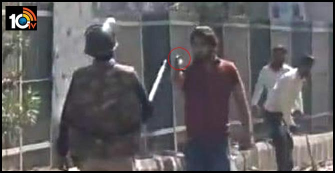 Viral video shows man with gun charging at policeman during in Delhi Clashes