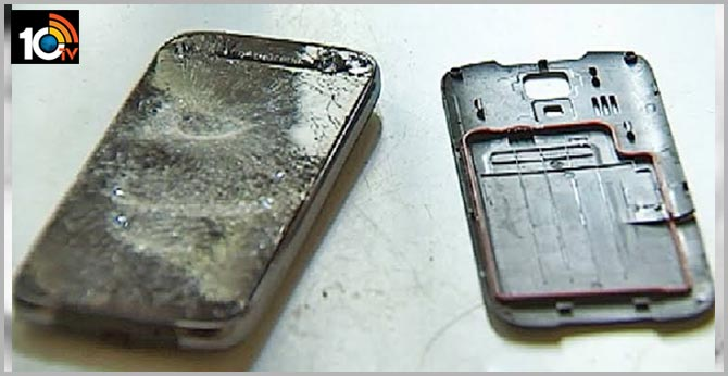 Exploding Cell Phone In Woman's Hand