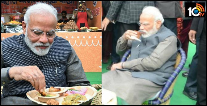 PM Modi savours Litti Chokha with Kulhad chai at Hunar Haat. See photos
