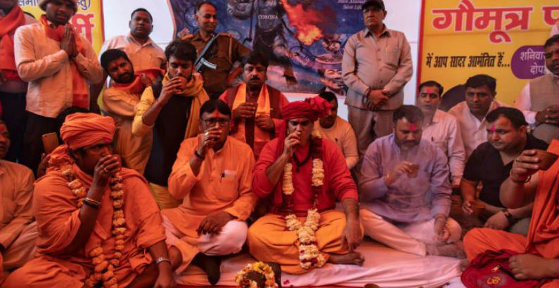 Publicity-hungry swami drinks cow urine at Delhi party to piss off coronavirus, may go viral