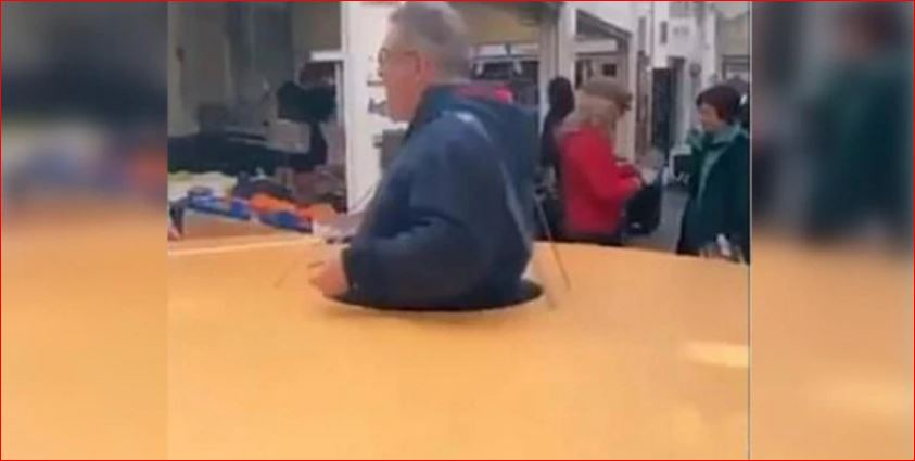 Coronavirus: Italian man wears large disc to enforce social distance. Twitter calls him a genius