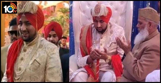 Muslim bride groom tie a Sikh turban on his wedding