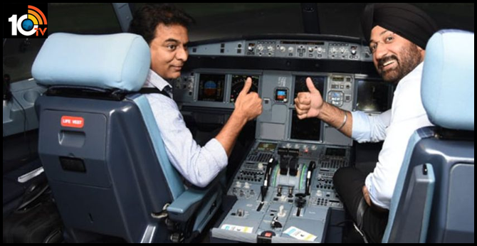 minister ktr having a experience of the flight simulator after inaugurating fstc at shamshabad avr