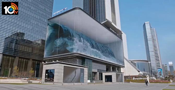 Worlds Biggest Virtual Wave Crashes Against Glass In Optical Illusion