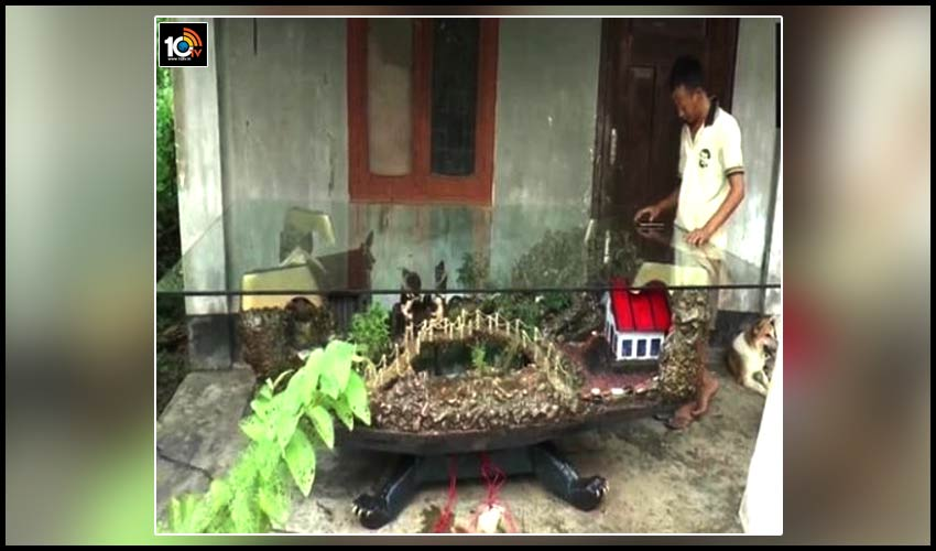 nagaland-sculptor-crafts-beautiful-village-on-a-wooden-table