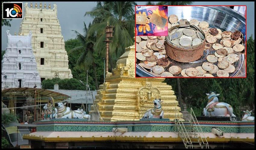 silver-coins-and-copper-sri-sailams-ghantamath-lard-shiva-temple-wall