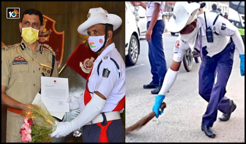 హ్యాట్సాఫ్ పోలీసన్నా.. : చీపురుతో రోడ్లు ఊడుస్తున్న ట్రాఫిక్ పోలీస్