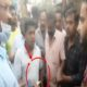YCP activists distributing money to voters in ration distribution vehicles
